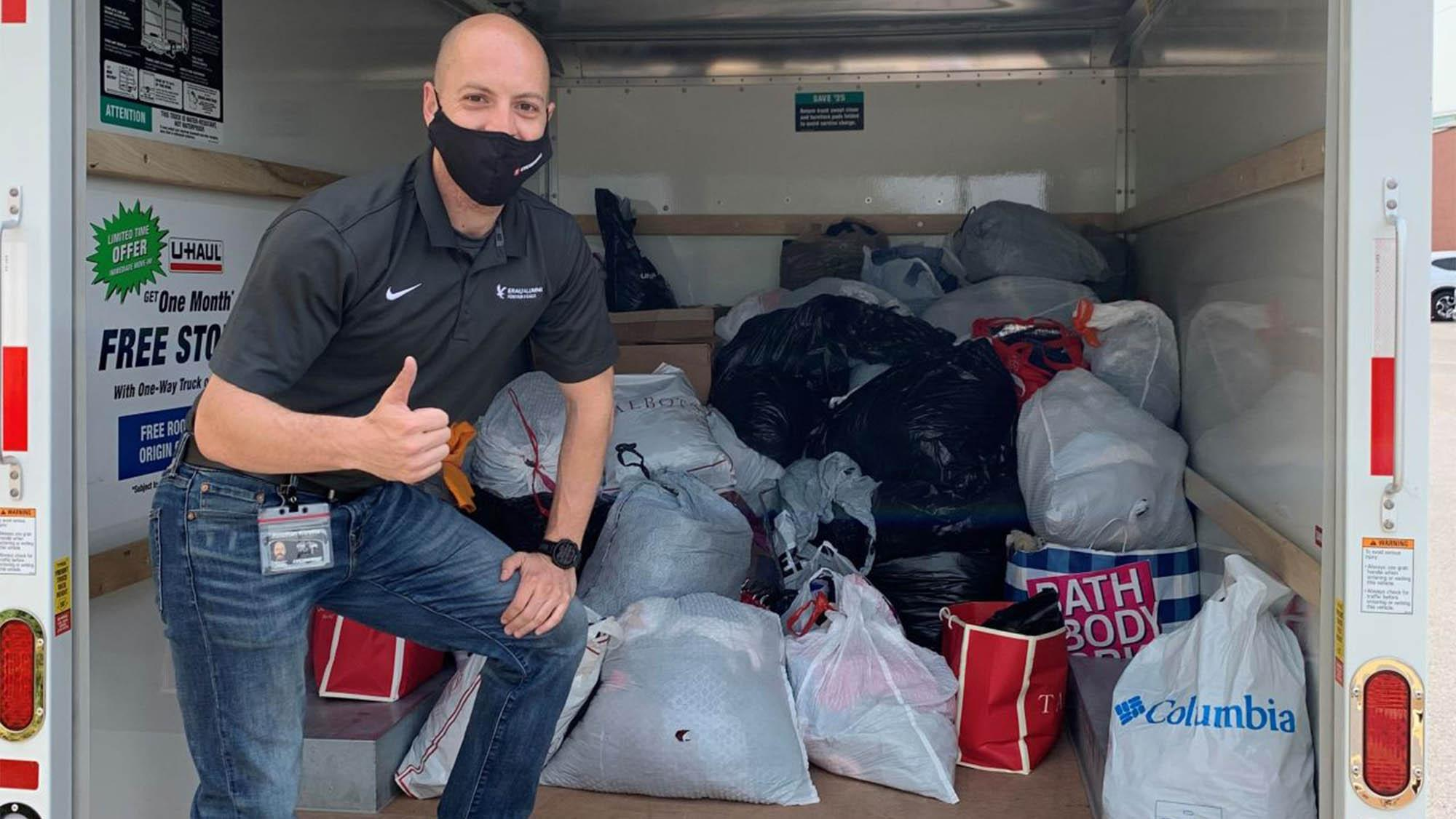 Jonathan Korelitz delivering over 700 lbs of clothing to the local AIDS Resource center.