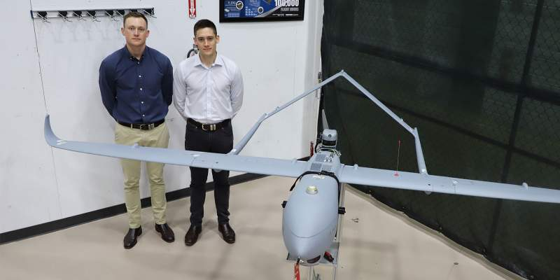 Australian Cadets Standing Next to Aerosonde