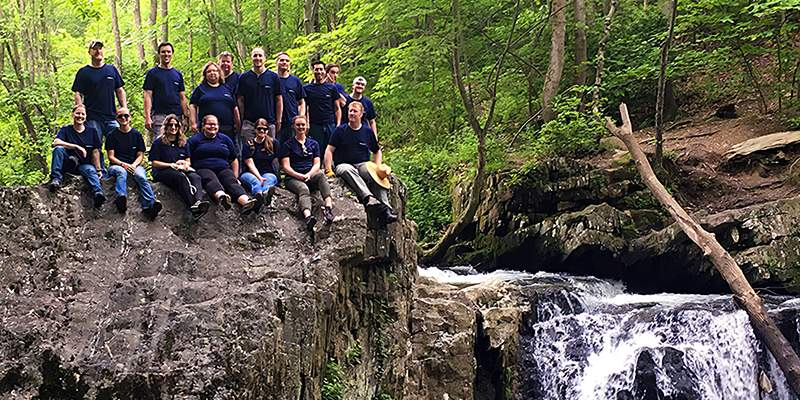 team members by a river